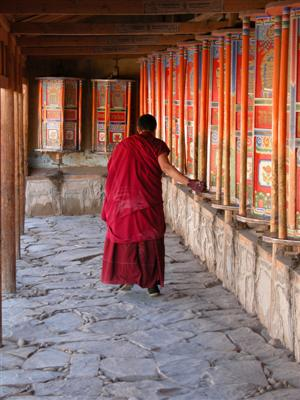 Xiahe, China - Labrang Monastery Monk Spinning Prayer Wheels